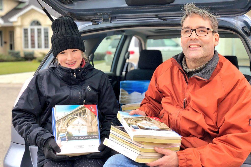 Volunteers Holding Books