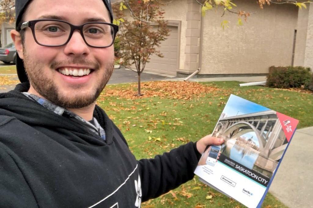 Saskatchewanderer holding Saskatoon phone book